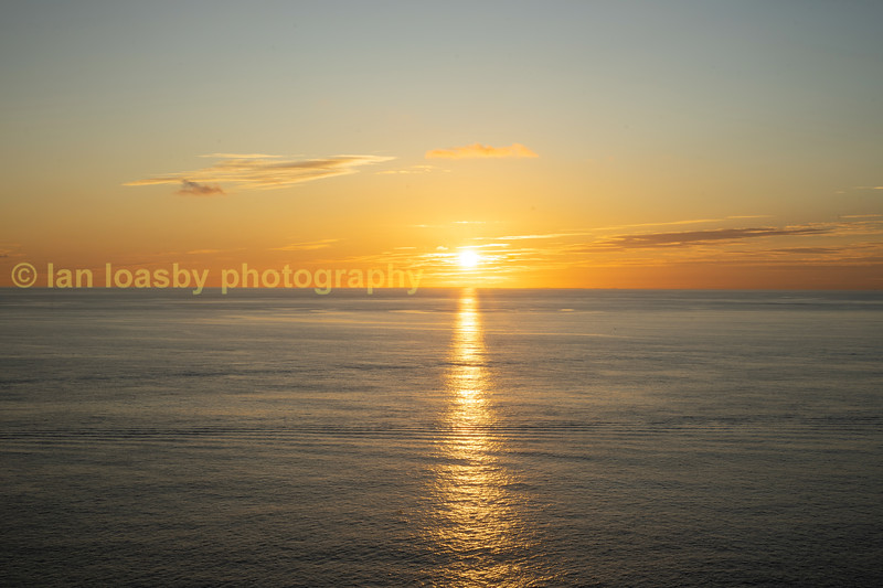 If you look very carefully just below the setting sun on the horizon you can see the Scilly islands