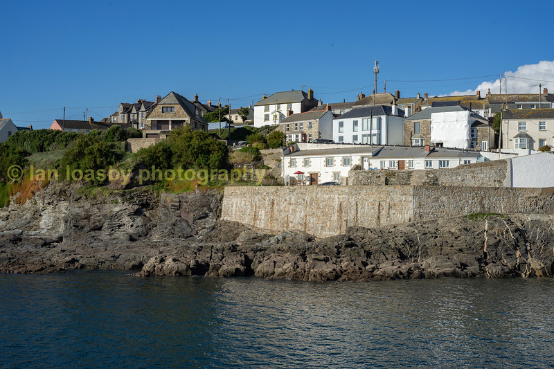 A hoiday let we have stayed in at Porthleven ( the white cottage  directly)behind the red umbrella