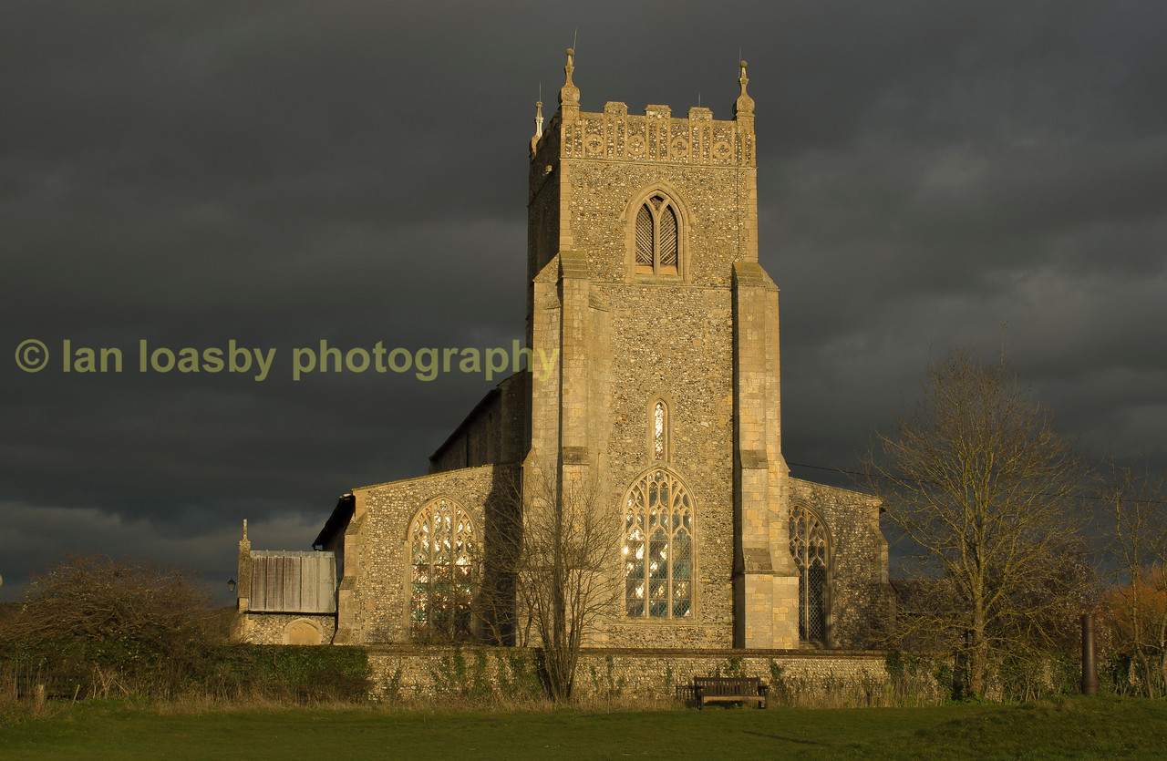 Sunset on a typical north norfolk village church