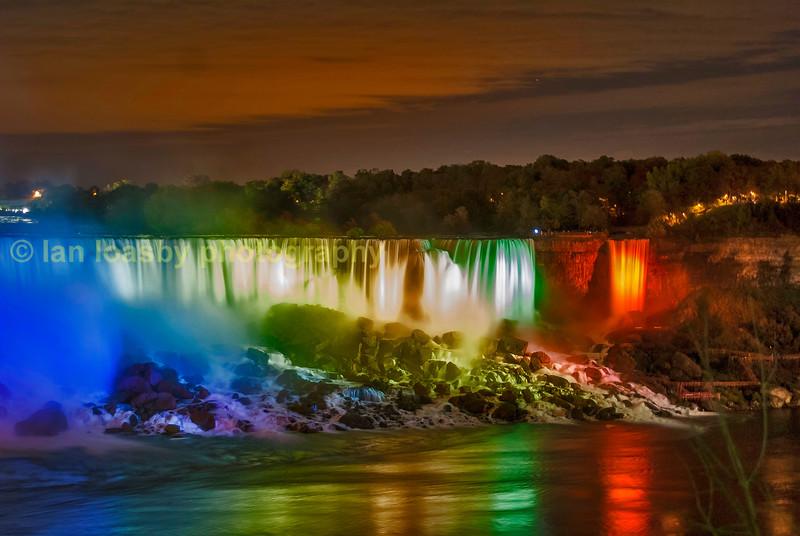 Niagara falls floodlit at night