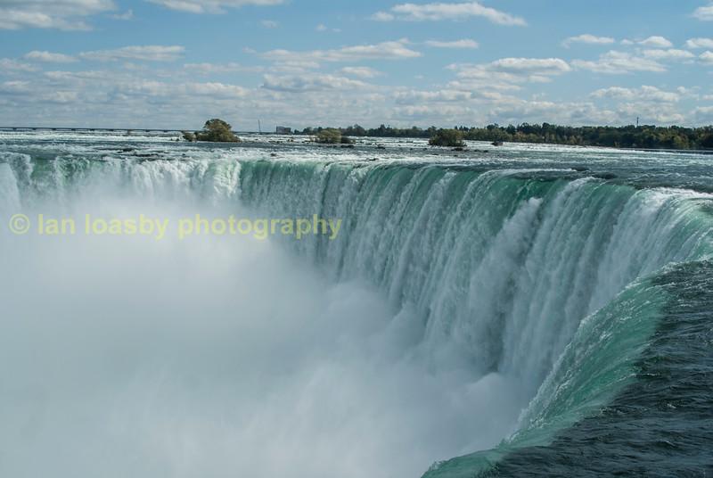 Awesome,  the river Niagara  tumbles over horseshoe falls