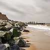 Happisburgh beach with old and new seas defences