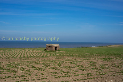 WWII 'pill boxes' ( concrete fortifactions ) line the cliff tops at Happisburgh.  In an earlier visit a few years ago i found one of these concrete constructions up turned on the beach after it had been washed away along with the field and cliff it had been stoood on, eventualy this 'Pill Box' will face the same fate