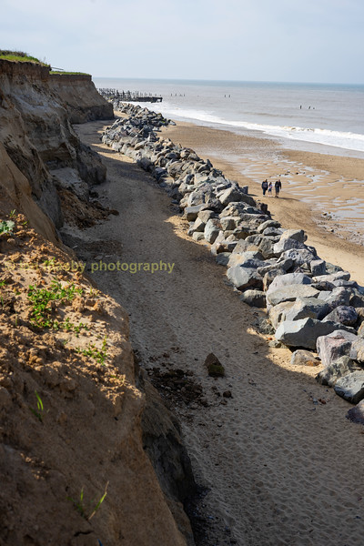 A look north towards Cromer from the top of the access ramp to the beach of the extent of the boulder sea defence