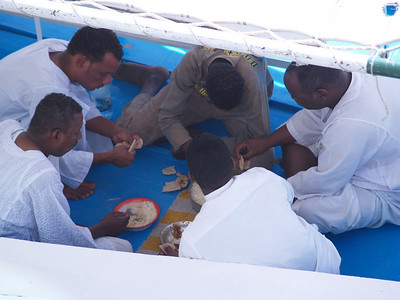 Egypt. Scenes from the Nile. Gathered for a quick lunch on a felucca.