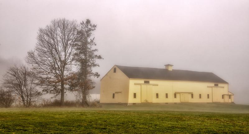 Barn on a foggy morning