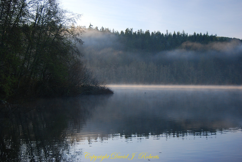 A quiet summer morning on Lake Padden with spectacular cloud formations in early morning hours, Bellingham, Washington