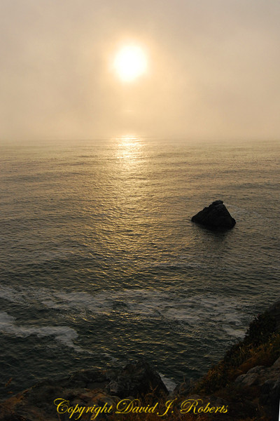 A foggy sunset as seen from the cliffs of Patrick's Point State Park, northern California