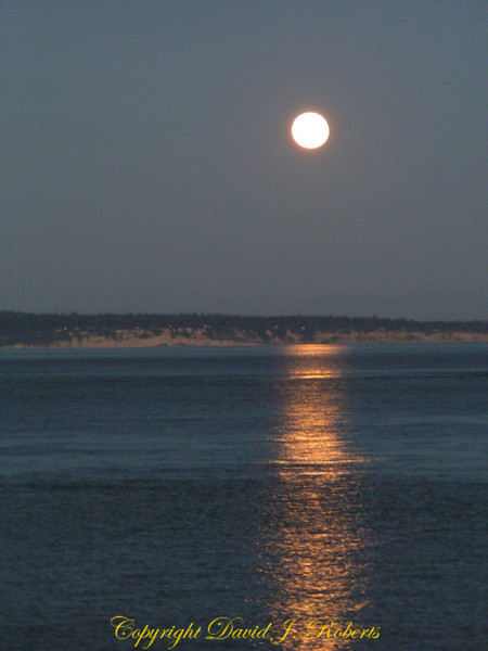A spectacular moon reflection on Puget Sound west of Whidbey Island captured from the ferry from Port Townsend, Washington