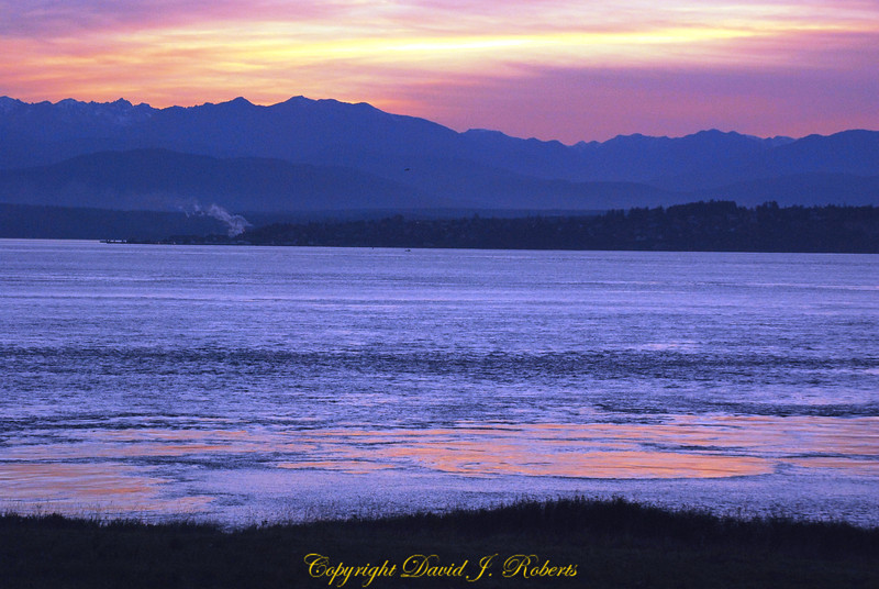 View of Olympic Mountains and Puget Sound from Fort Casey in gorgeous pink and purple light