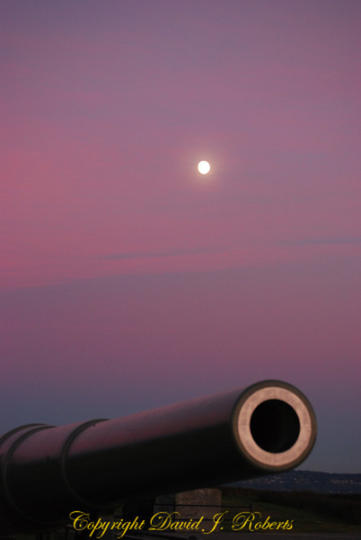 Cannon at Fort Casey Washington in the early evening light with moon hanging in the background