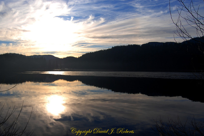 Lake Padden with spectacular winter cloud formations in early morning hours, Bellingham, Washington.