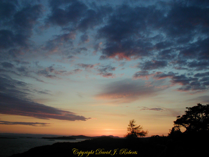 A spray of clouds in the sunset over Lopez Island, Washington