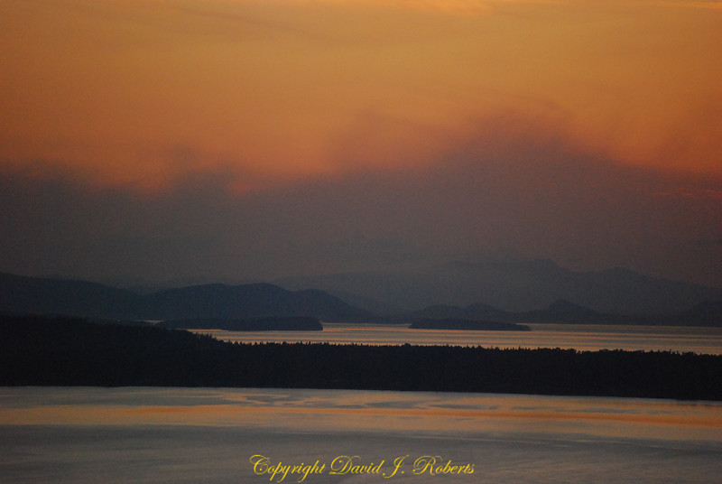 Looking across Bellingham Bay from Samish Highlands on a foggy sunset evening.