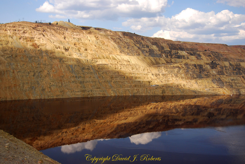 Reflection on the water in Berkely Pit, Butte, Montana