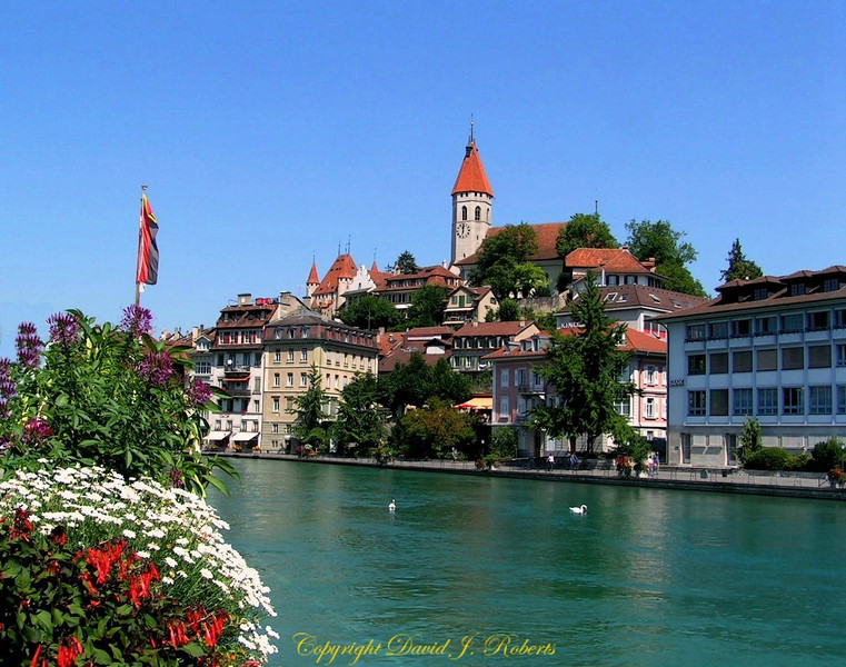 Town of Thun with castle and the Thun River in central Switzerland.