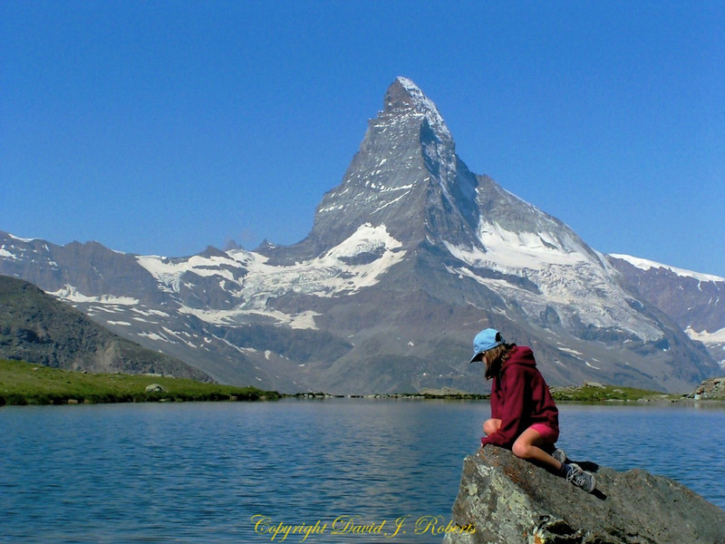 My daughter Rachel contemplates what is in the water of a small tarn across the valley from the Matterhorn