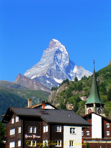 The Matterhorn as seen over the rooftops of Zematt, Switzerland.