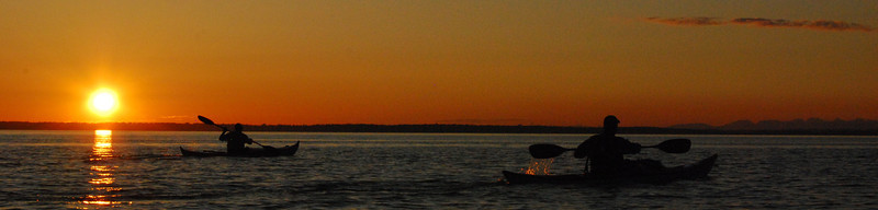 Kayakers in the sunset, Bellingham Bay, Washington - panorama