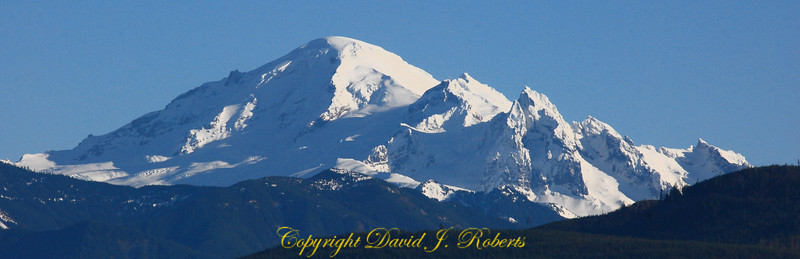 A panorama winter view of Mount Baker from the Noon Road in Whatcom County near Bellingham. <br /> <br /> (This photo can be purchased in a variety of formats. When you get it, just cut the white area to produce the panorama.)