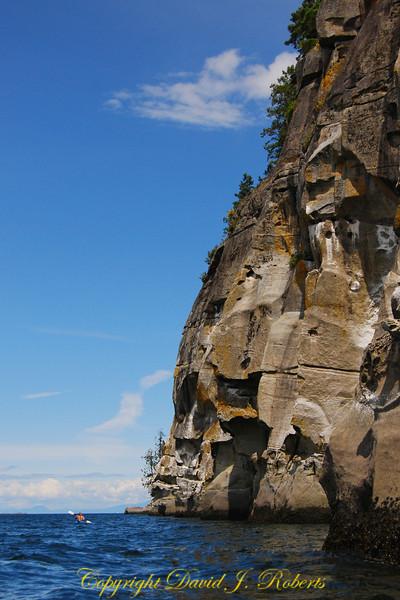 Allison kayaking below cliffs Gabriola Is