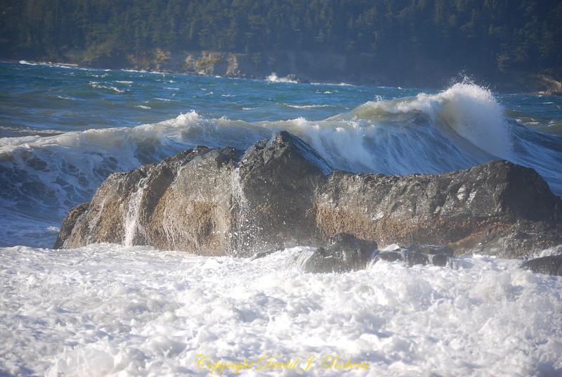 Waves crashing on the shore at Deception Pass State Park, Washington