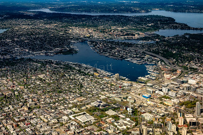 Lake Union (middle), Interstate-5 freeway, the Space Needle/Seattle Center (lower center). Queen Anne Hill (lower left) and Lake Washington (upper half) as seen from Alaska Airlines Flight 605 04/16/2016