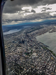 Looking South from Queen Anne Hill past Seattle to Sea-Tac. Sea-Tac Airport is in the upper right-hand corner below the horizon.  04/07