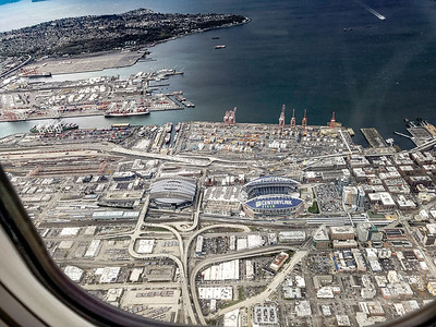 Safeco and CenturyLink fields and the Port of Seattle and West Seattle is in the background from roughly 4,000 feet in the air taken from an Boeing 737. 04/07/2017