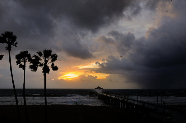 """Sunset Rain Storm"".  Manhattan Beach pier at sunset prior to a big thunderstorm."