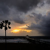 """Sunset Rain Storm"".  Manhattan Beach pier at sunset prior to a big thunderstorm."