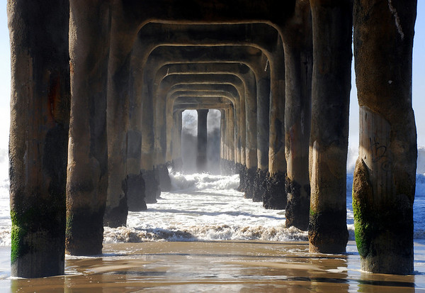 """Underneath Big Wednesday"". Large swells off the Manhattan Beach Pier 12/5/07. Manhattan Beach, CA"