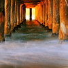"""Sunrise Solitude"".  Warm winter light illuminates the pier."