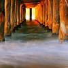"""Sunrise Solitude"".  Warm winter light illuminates the pier."