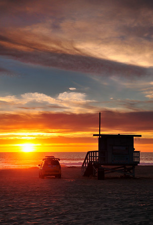 """""""Closing Time"""".  Manhattan Beach lifeguard waits till sunset to close up shop. Image published on the Front Cover of the """"South Bay Monthly"""" Magazine, March 2010 (Torrance, Redondo Beach Issue)."""
