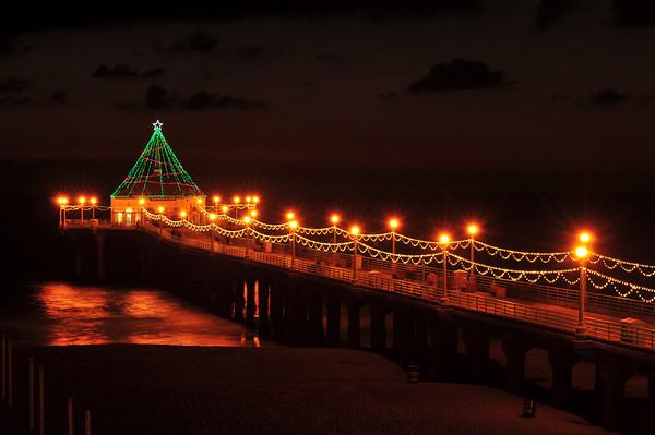 """Holiday Night"".  Night shot of the Holiday Pier Lighting, Manhattan Beach, CA."
