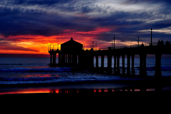 """""""Winter Light Reflections"""". Storm front approaching the Manhattan Beach Pier.   Image published on the Front Cover of the """"South Bay Monthly"""" Magazine, December 2011 (Manhattan Beach, Hermosa Beach, Redondo Beach & El Segundo Issue)."""