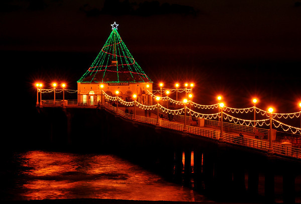 """Holiday Glow"".  Holiday Pier Lighting, Manhattan Beach, CA.   Image published on the Front Cover of the ""South Bay Monthly"" Magazine, December 2011 (Manhattan Beach, Hermosa Beach, Redondo Beach & El Segundo Issue)."