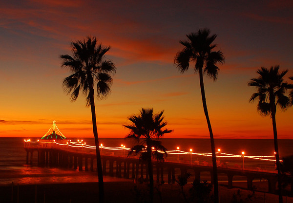 """Holiday Pier 2007"".  Image published on the Front Cover of the ""South Bay Monthly"" Magazine, December 2008 (Manhattan Beach, Hermosa Beach, Redondo Beach & El Segundo Issue).  ""2007 Manhattan Beach Holiday Pier Lighting"", Manhattan Beach, CA."