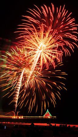 """Crimson Glow"".  Manhattan Beach Holiday Fireworks Festival 2009, Manhattan Beach, CA.   Image published on the Front Cover of the ""South Bay Monthly"" Magazine, January 2011 (Manhattan Beach, Hermosa Beach, Redondo Beach & El Segundo Issue)."
