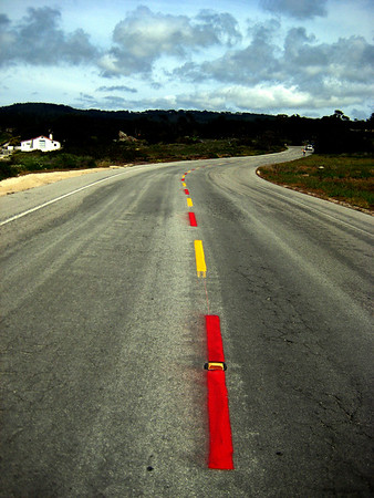 """Did a former USC graduate paint this road along """"17 Mile Drive""""?"""