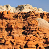 "Goblin Valley State Park, UT. ""Froggy"" a sculpted rock formation is perched above, watching over the amphitheater. <br /> From deposits laid approx. 170 million years ago, Goblin Valley State Park has been sculpted by forces of nature by the forces of wind and water.  The goblins are made of Entrada sandstone which shows evidence of being near an ancient sea millions of years ago. The edges of the sandstone weather more quickly producing spherical-shaped goblins."
