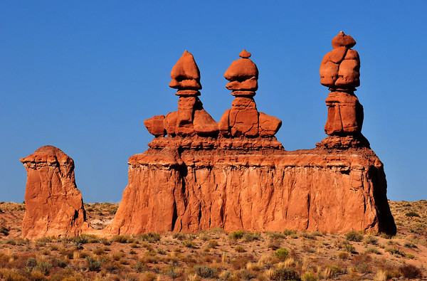 """The Three Judges"".  Goblin guardians welcome visitors as they enter Goblin Valley State Park, Utah."