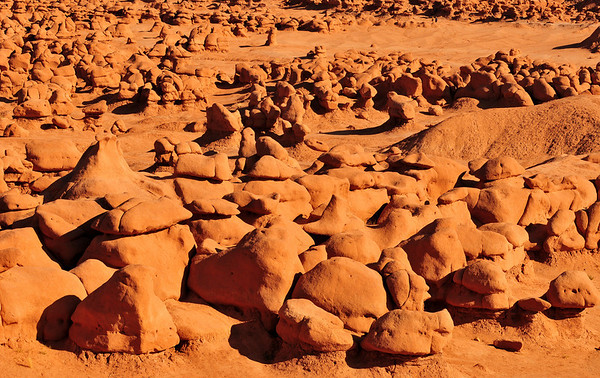 Goblin Valley State Park, UT. From deposits laid approx. 170 million years ago, Goblin Valley State Park has been sculpted by forces of nature by the forces of wind and water.  The goblins are made of Entrada sandstone which shows evidence of being near an ancient sea millions of years ago. The edges of the sandstone weather more quickly producing spherical-shaped goblins.