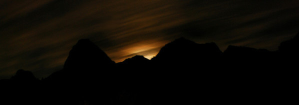 Moon rising over Zion National Park at midnight.