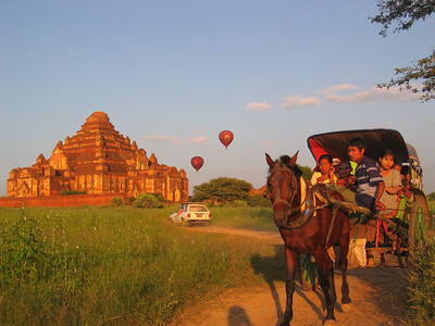 Hot air balloons, horse carriage, car and temple Bagan Myanmar