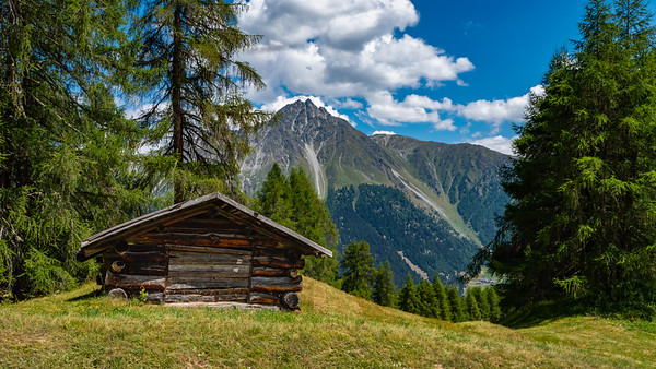 Alpine Hut on the Mountain Pasture