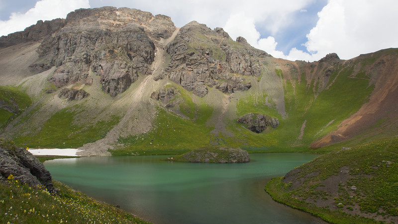 Nestled high in the San Juan Mountains of Colorado, Island Lake lieshigh in a mountain bowl well above the tree line. The guide book strongly counsels against trying to swim to the island even on the hottest day, as the icy waters will quickly sap your strength.