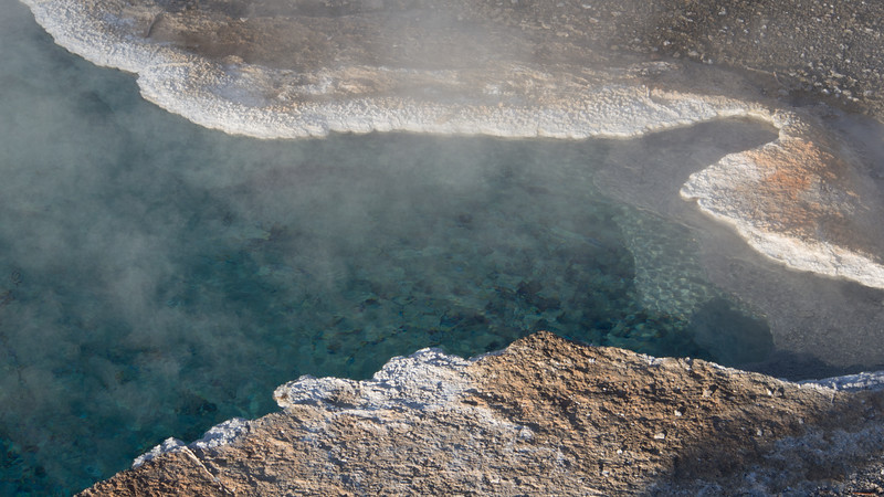 The water in this geothermal pool is crystal clear and scalding hot.<br /> <br /> Geyser Hill, Yellowstone National Park.