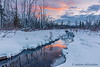 Sunrise over small winter creek in Innisfil, Ontario, Canada